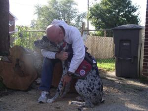 Service dog, JP, with veteran Bill Austin