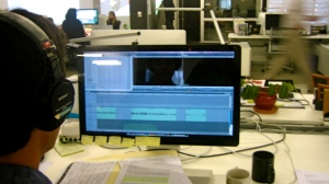 Adrian Florido at his desk editing segment