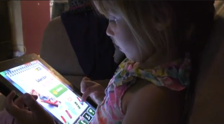3-year-old Madison plays an educational game on an iPad. She uses it at least once a day for no more than one hour.