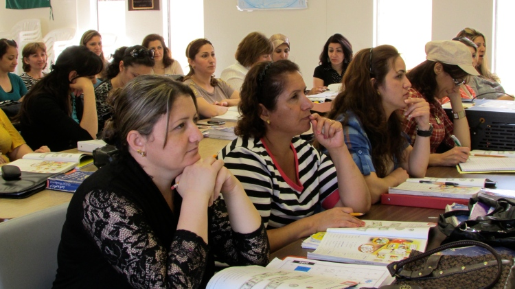 Refugees in San Diego attend a class at the Kurdish Human Rights Watch to learn English.