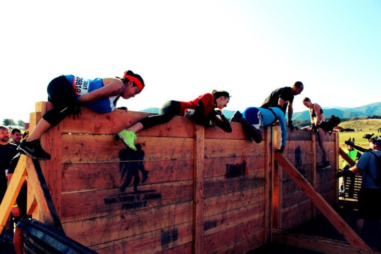 Competitors tackle one of Tough Mudder's obstacles. Photo by Emily Stanford