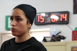 Amateur boxer Azalea Garcia anxiously waits to spar another female. Photo by Adriana Bush