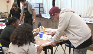 Gonzalez teaching art classes at O'Farrell Community School with other volunteers after class