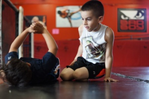 Two boys play around in between jiu-jitsu practice at Alliance Training Center in Chula Vista, Calif. on Monday, April 21, 2014.