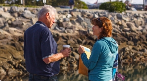 Peter Halmay and Theresa Talley discussing dockside market locations before the pierside market opens for the day, Saturday, April 19, 2014, in San Diego, Calif.
