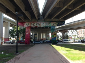 "The ""All the Way to the Bay"" mural is one of the original artworks done at Chicano Park. Hector Villegas helped restore it in 2012."