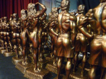 Trophies lined up backstage at an NPC competition, waiting to be awarded to the top five competitors in each height class. Photo by Megan Looney.