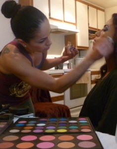 Rios, also a certified makeup artist, helps another competitor get ready for show day. Photo by Megan Looney.