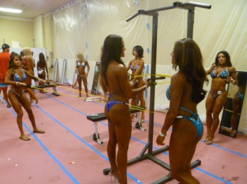 """National Physique Committee competitors """"pumping up"""" before getting on stage. Photo by Megan Looney."""