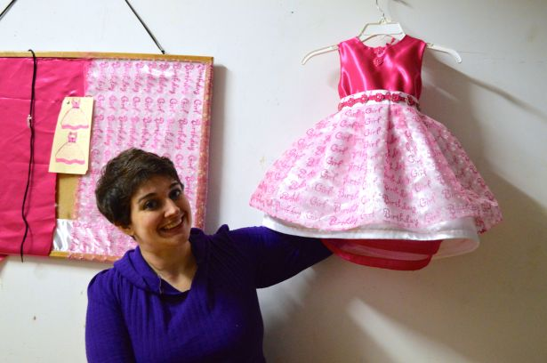Victoria Roberts of WishNow shows off a pink, custom-made party dress in her studio.