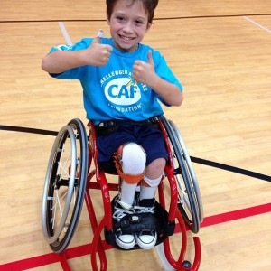 Hunter shows off his specialized BOX basketball wheelchair, which he received through a grant from the Challenged Athletes Foundation.