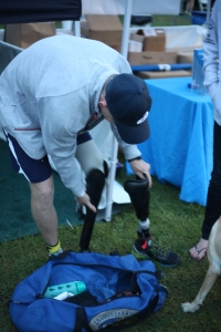 Johnston switches to his cycling leg before his race. His prosthetics are made by a local company that specializes in making adaptive limbs for athletes.