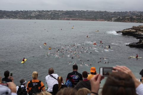 Triathlon participants swam in the Cove in La Jolla for the first leg of the race. Some athletes swam with guides with one boy being pulled in a boat by his brother.