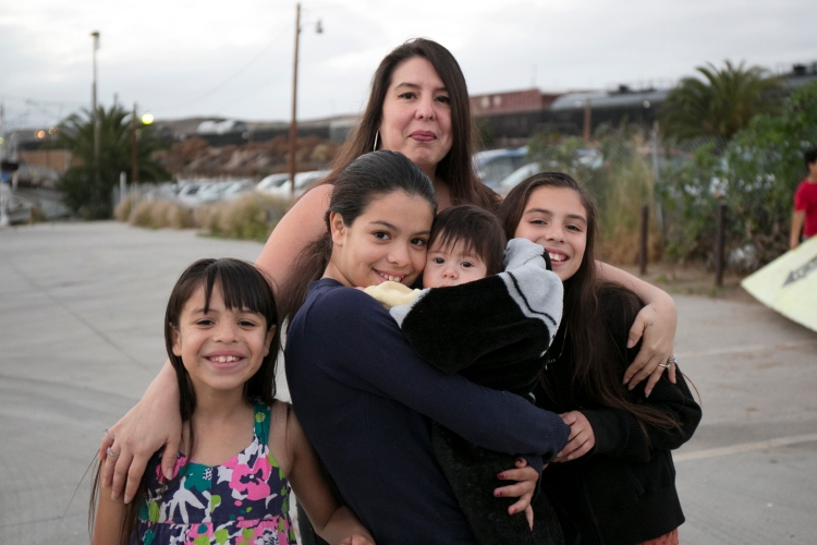 Rachel Quintana and her daughters pictured outside of their San Ysidro Motel room. Her children all attend Willow Elementary where almost half of the students are considered homeless.
