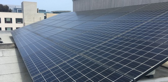 California's goal to source 50 percent of its energy from renewables by 2030 comes with challenges, uncertainty. Rooftop solar panels at University of California San Diego. Photo by Hallie Hoffmann